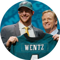 Carson Wentz smiling at crowd on draft signing day
